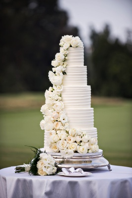 five-tier wedding cake with cascading waterfall of ivory flowers