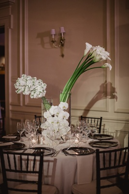 modern wedding centerpieces with white calla lilies, orchids, and stock flowers