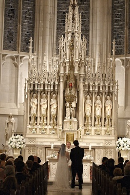 Bride and groom at St. James Chapel altar