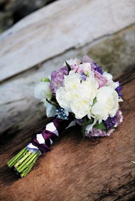 Bride's bouquet of white and purple flowers