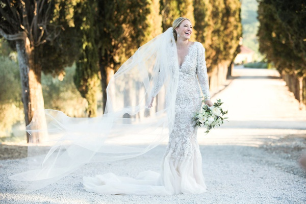 bride in marchesa wedding dress long sleeves v neck mermaid, cathedral veil