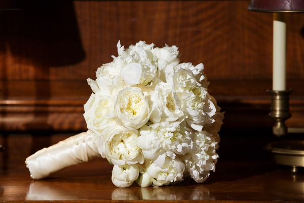 Wedding bouquet white peony white garden rose flowers wrapped with satin ribbon ivory white bouquet