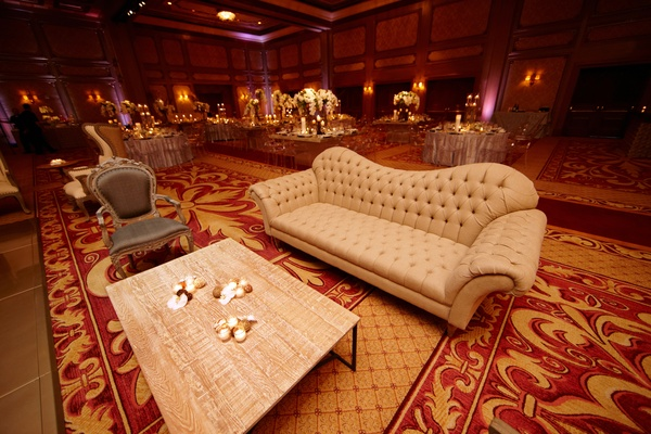 Chaise sofa with tuft details in ballroom wedding lounge