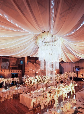 wedding reception guatemala ruins chandelier flower with drapery twinkle lights overhead