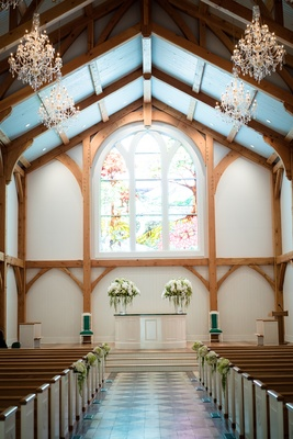 chapel ceremony venue stain glass windows west virginia greenbrier hotel resort pews wedding