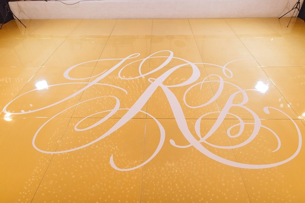 gold white custom dance floor initials pelican hill details california wedding venue