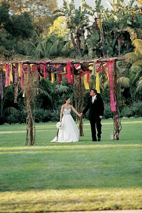 Vibrant-colored fabric hanging from brown canopy