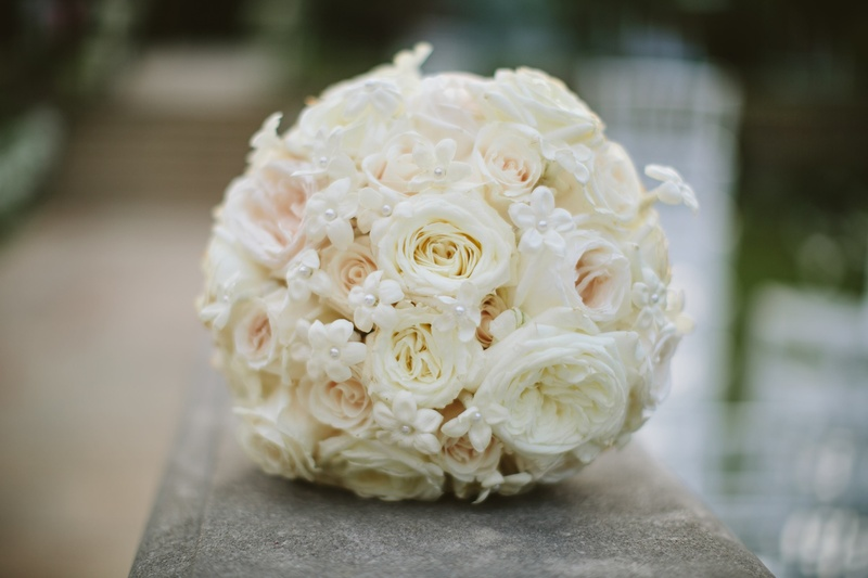 White and blush roses with pearl-dotted florals