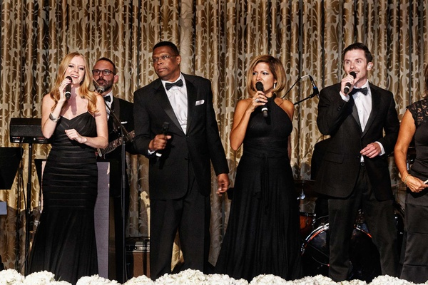 Live band in all black dresses and tuxedos at Chicago wedding reception on stage