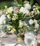 wedding reception low centerpiece gold footed vase white hydrangea rose pink dahlia flowers