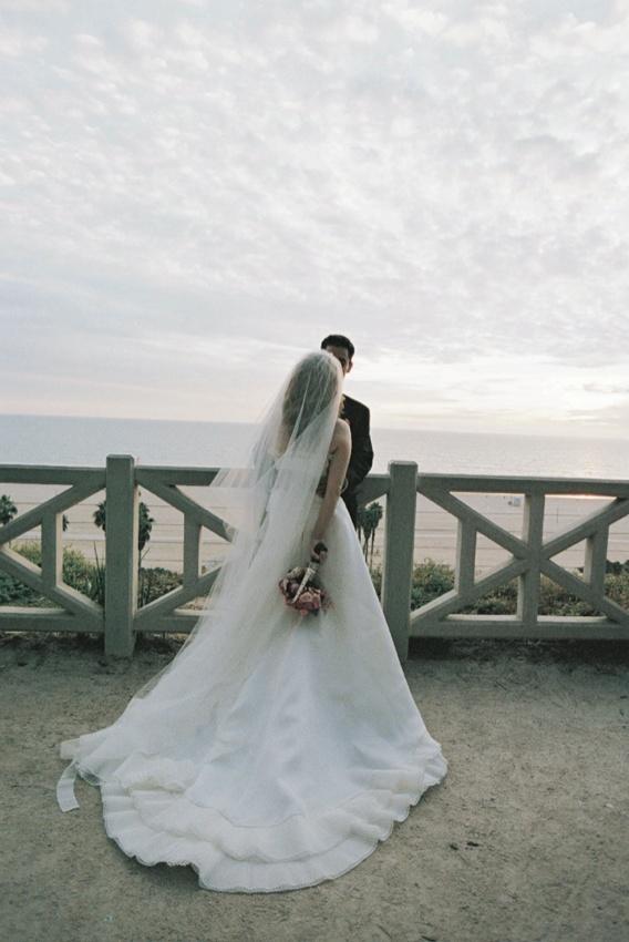 Vera Wang bridal gown beachside