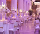 Marble column wedding venue with white and gold decorations