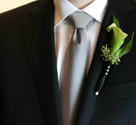Groom suit lapel with green and white mini calla lily