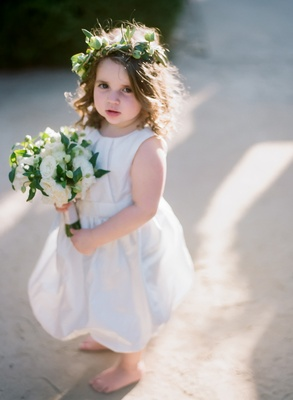barefoot flower girl with crown of greenery and bouquet