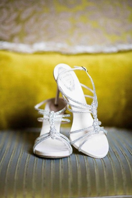 White wedding shoes with straps and crystals