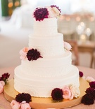 Wedding cake four layer white design fresh flowers dahlia garden rose pink burgundy gold stand