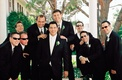 Groom and groomsmen in suits and sunglasses