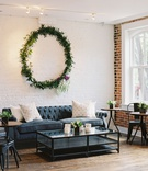 wedding reception event lounge chesterfield tufted sofa coffee table bistro table metal chair wreath