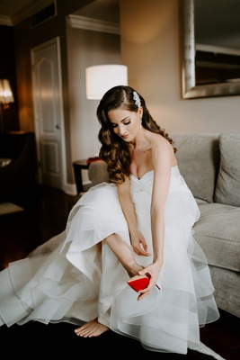bride with long brunette hair soft curls old hollywood look nude christian louboutin heels red soles