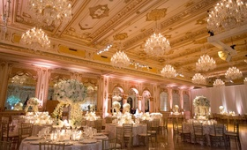 Wedding reception opulent sophisticated ballroom with chandeliers gold ceilings high low centerpiece