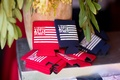 Red and blue flag printed coozies with couple's names and date