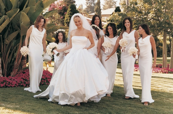 The bride with her bridesmaids in garden