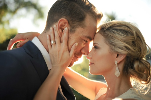 Tim Lopez and Jenna Reeves wedding couple portrait sunlight teardrop engagement ring earrings