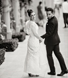 black and white photo, groom in ralph lauren black label funny face, bride in oscar de la renta