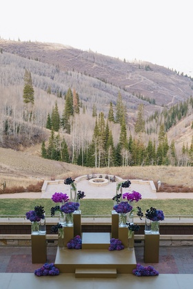 Wedding ceremony outdoors Montage Deer Valley purple flowers gold decorations view of mountain
