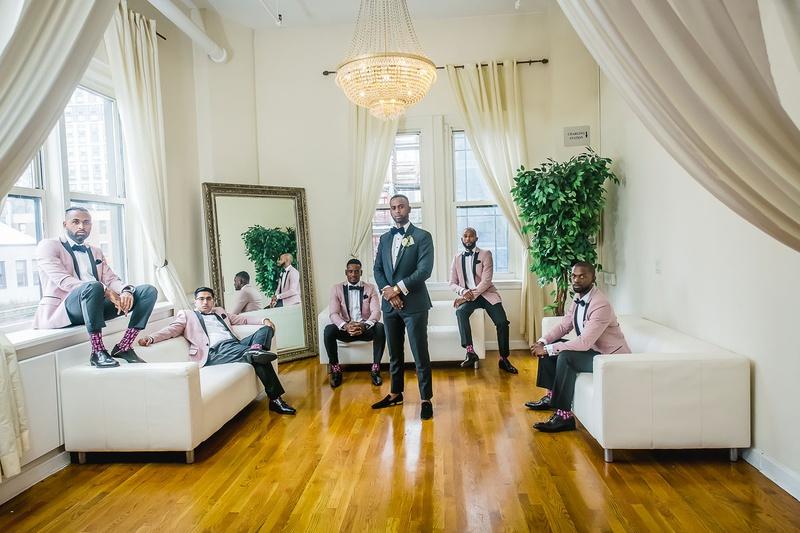 groom in tuxedo, groomsmen with dusty pink tuxedo jackets