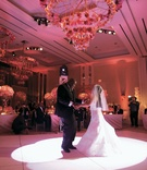 bride and groom dance on pink dance floor