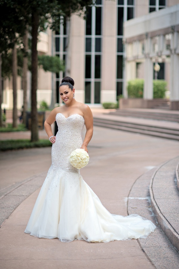 Wedding dresses photos beaded trumpet style wedding dress inside bride holding bouquet wearing strapless bridal gown junglespirit Images