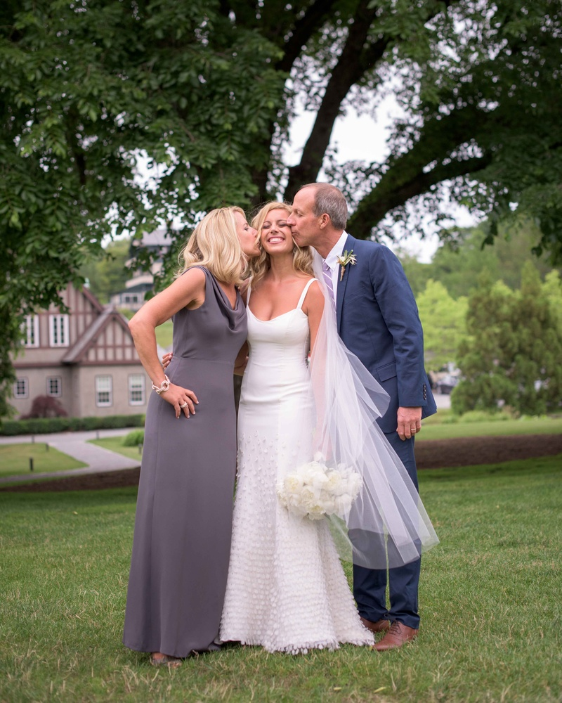 Guests & Family Photos - Parents Kiss Bride on Cheek - Inside Weddings