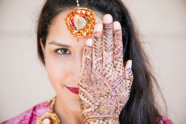 wedding beauty look for hindu bride interfaith wedding ceremony henna mehndi purple accents
