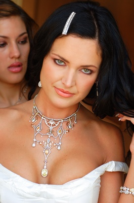 bride wears beautiful diamond and jeweled necklace