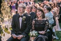 wedding ceremony mother of bride in black lace illusion oscar de la renta dress father in bow tie