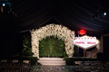 wedding ceremony white chuppah greenery hedge wall vow renewal surprise chapel of the bells vegas