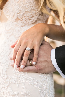 Bride with white light pink manicure nails with halo round engagement ring groom's yellow gold band