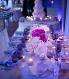 Blue lighting at wedding reception with purple color palette