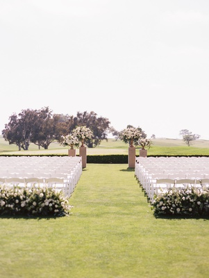 outdoor wedding ceremony the lodge at torrey pines greenery white rose flowers chairs golf course
