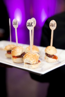 Miniature hamburger slider with sesame seed bun and custom tooth picks
