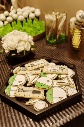 golf-themed cookies and golf desserts at wedding sweets table