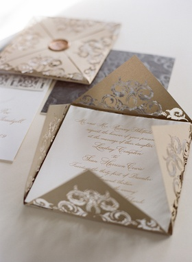 Metallic gold and silver lasercut wedding invite