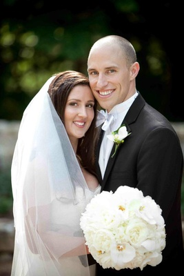 Bride and groom with ivory bouquet and silver bow tie