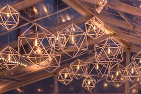 clear-topped tent, geometric light fixtures with round edison filament light bulbs