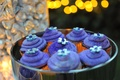 Purple cupcakes with silver flowers