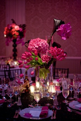 Pink multi flower wedding centerpiece and sequin linens