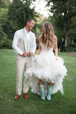 Katrina Hodgson in teal blue cowboy boots on wedding day