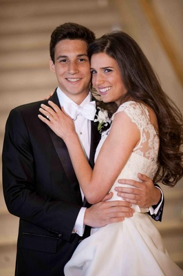 Bride in a Monique Lhuillier gown and groom in a black tuxedo
