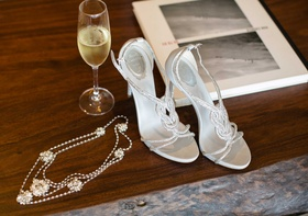 Bride's wedding day accessories headpiece and Rene Caovilla heels sandals crystal details straps